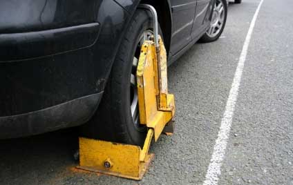 A CONTROVERSIAL car clamping boss has boasted how he has made an astonishing GBP10 MILLION from towing away motorists.