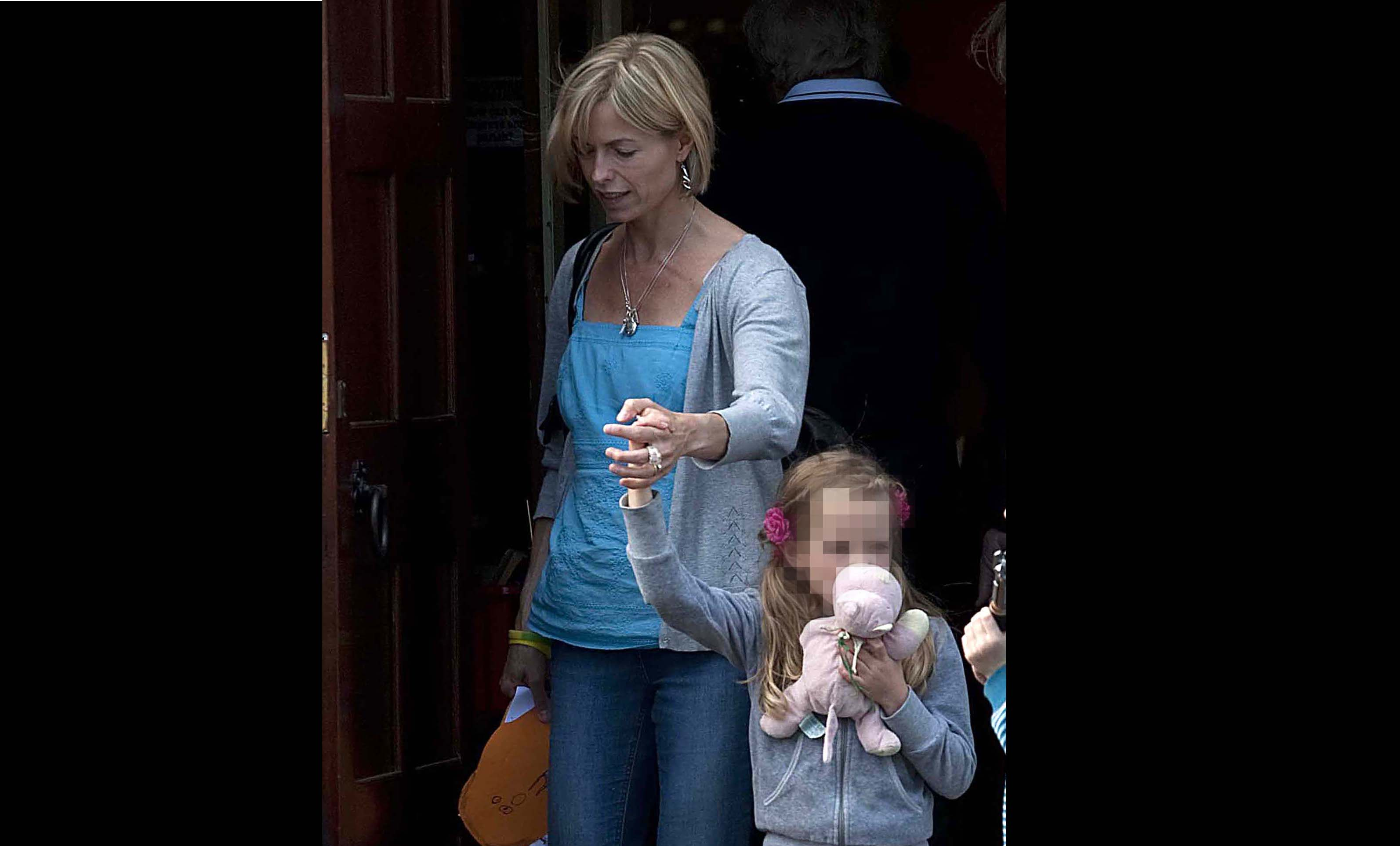 Kate McCann leaves with her daughter after attending the Church of the Sacred Heart in Rothley,