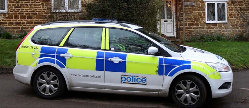 Banned driver crashes into police car