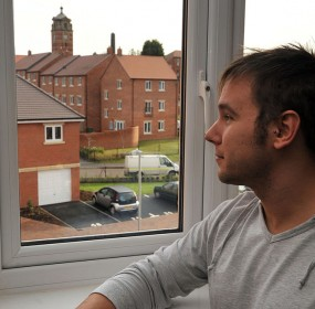 24 year old Andrew Watson, who has recently bought an appartment at the old Wordsley Hospital site, Wolverhampton, where he was born 24 years ago.