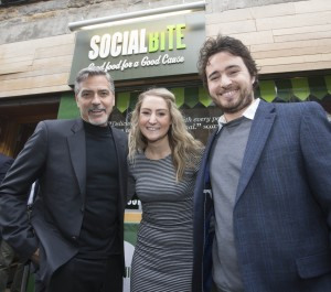 George Clooney with Josh Littlejohn and Alice Thomson, founders of Social Bite, outside the café on Rose Street, Edinburgh.