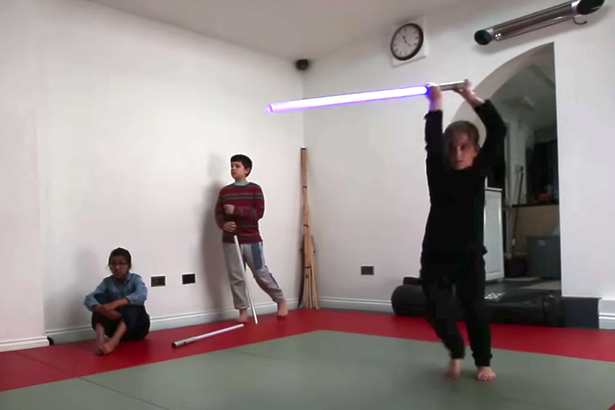 JEDI TEACHES CHILDREN WAY OF THE FORCE AND HOW TO USE LIGHTSABERS