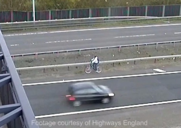 cyclist riding on m25