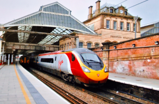 BRITAIN'S BIGGEST RAIL FAN PHOTOGRAPHS EVERY TRAIN STATION IN BRITAIN