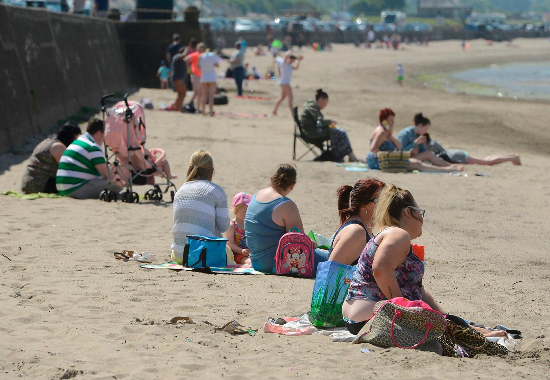 SCOTS SOAK UP GLORIOUS SUNSHINE AT BEACH