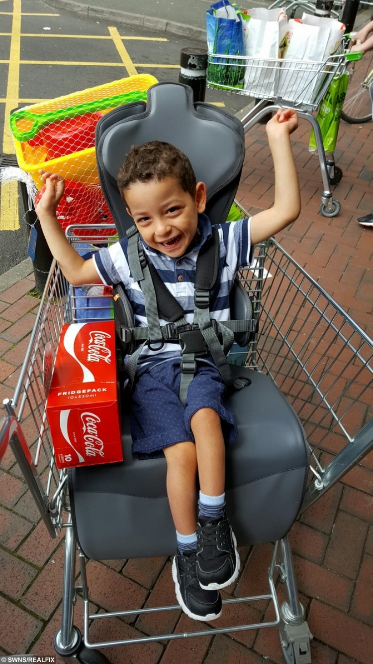VIRAL PIC OF DELIGHTED DISABLED LAD AFTER FIRST RIDE IN SUPERMARKET TROLLEY