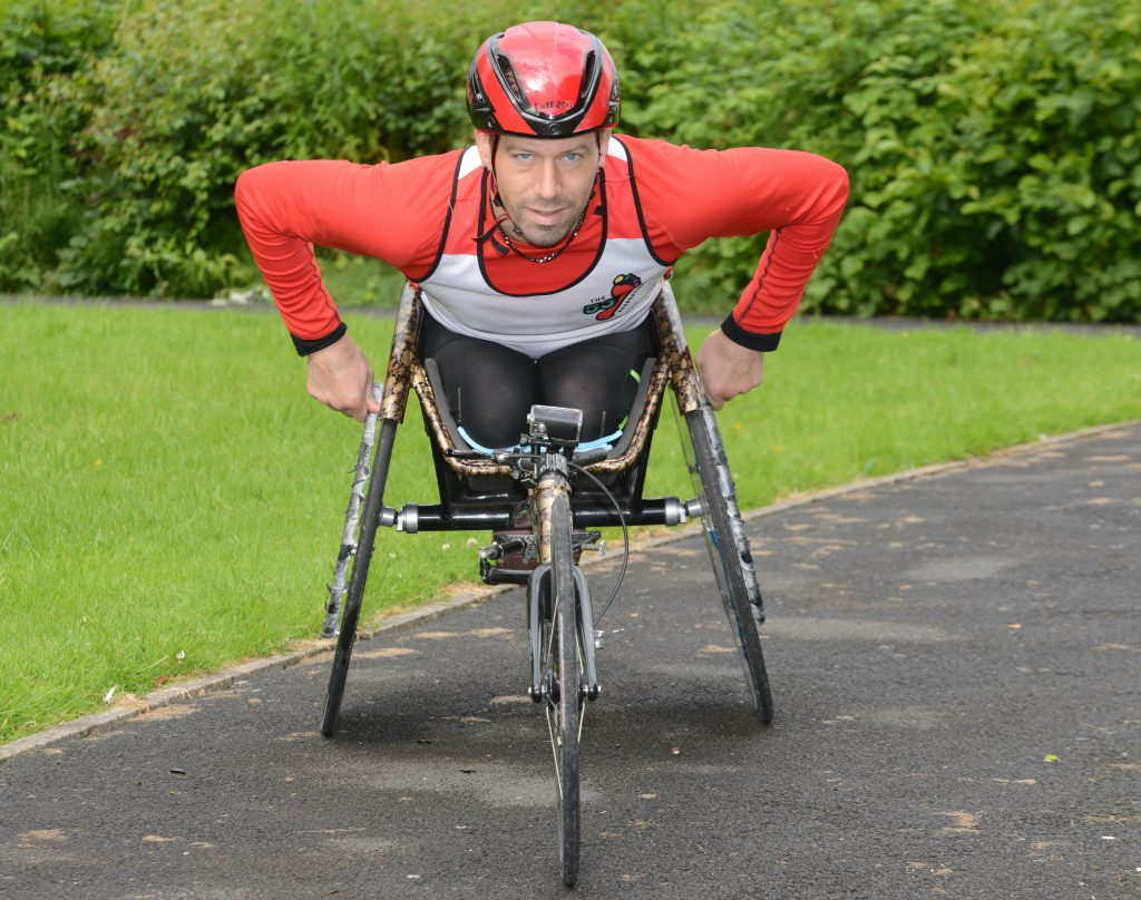 MAN SMASHES LAND'S END TO JOHN O'GROATS WHEELCHAIR RECORD