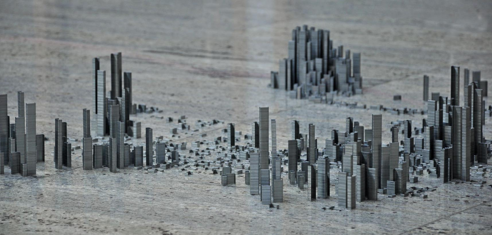 Artists creates cityscape out of 100,000 staples