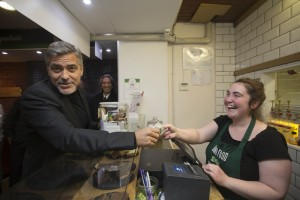 George Clooney hands buys a sandwich at Social Bite, a not-for-profit chain of sandwich shops.