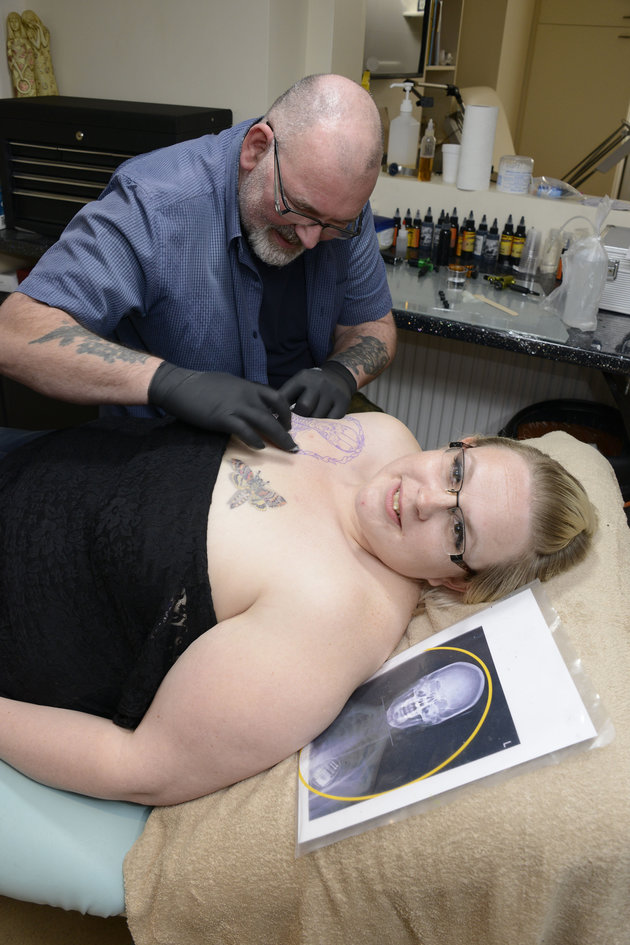 MUM GETS DAUGHTER'S BRAIN TATTOOED ON HER CHEST