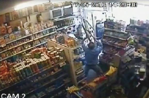 CCTV SHOWS HERO SHOPKEEPER FIGHTING OFF ROBBER WITH STEP LADDERS