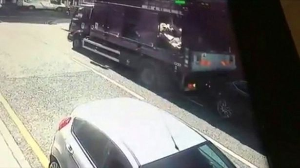 RUBBISH TRUCK CAUGHT ON CAMERA SMASHING INTO PARKED LEXUS