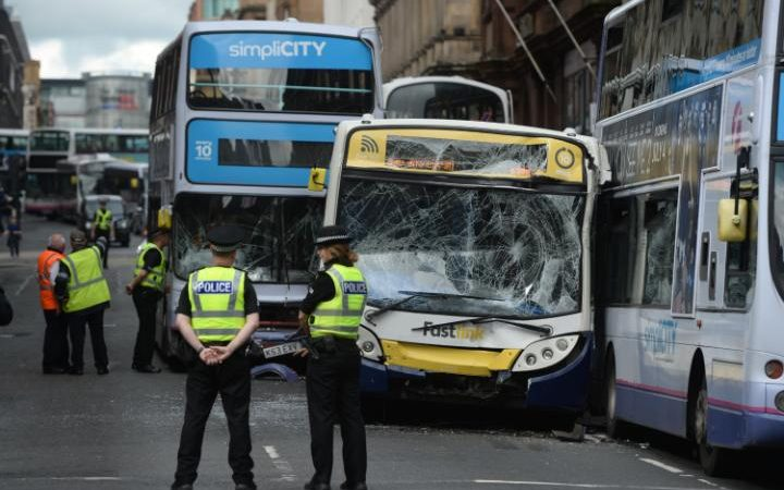 RUNAWAY BUS CRASHES AFTER DRIVER GETS OFF TO BUY A DRINK